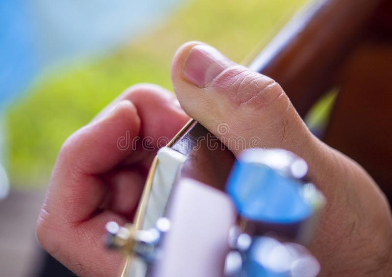 The musician plays an acoustic guitar stock photo