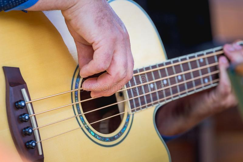 The musician plays the guitar. Concert popular music_. The musician plays the guitar. Concert popular music stock photo