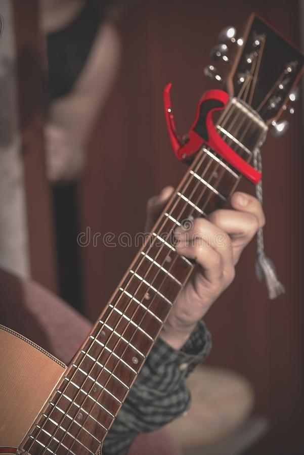 The musician plays the guitar. Generation millennium. Electric guitar Six strings. The guy is playing guitar. Generation millenites. Echo boomer musician royalty free stock photography