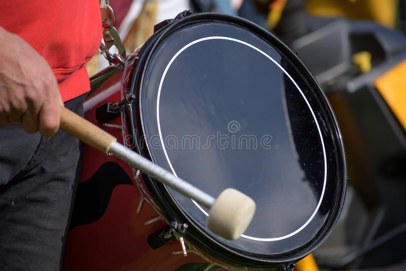 Musician plays the kettledrum in a corps of drums, motion blur. Musician plays the kettledrum in a corps of drums, selected focus, motion blur stock photos