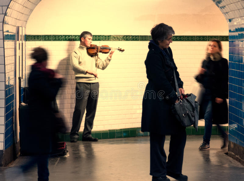 Musician plays violin subway royalty free stock image