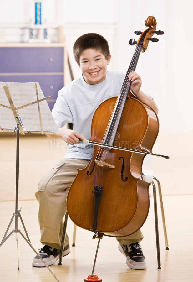 Musician practices performing on cello stock photos