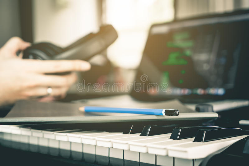 Musician prepare to writing his song in studio stock photography
