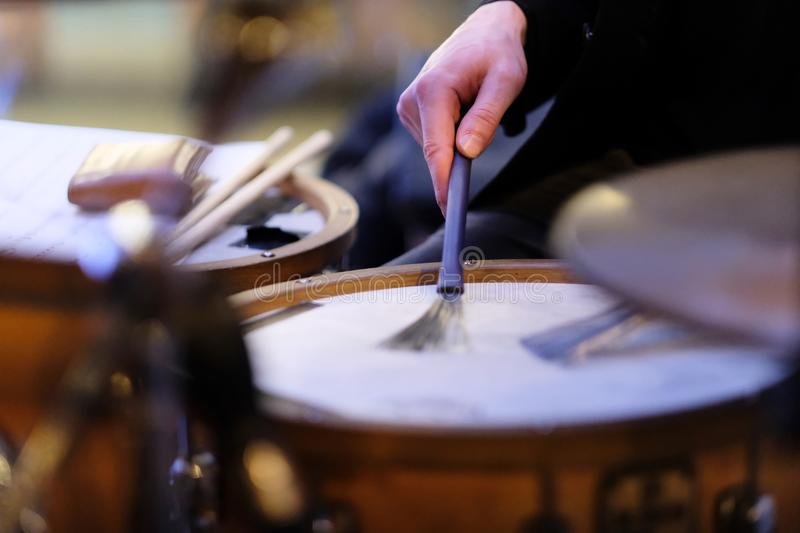 The musician`s hand on a drum set. The musician`s hand during performance of a composition on a drum set royalty free stock photography