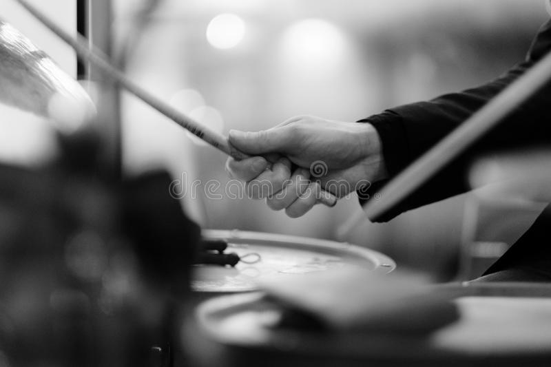 The musician`s hand on a drum set. The musician`s hand during performance of a composition on a drum set stock image