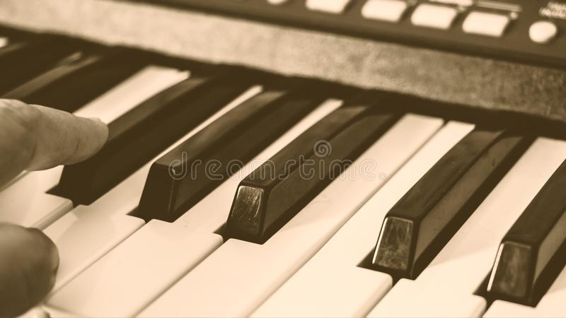 Hands on the piano stock photos