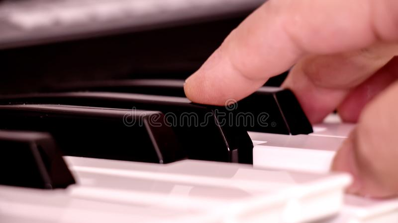 Hands on the piano royalty free stock images
