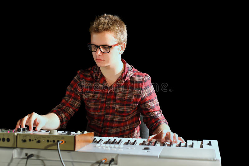Musician sits and plays electric organ royalty free stock images