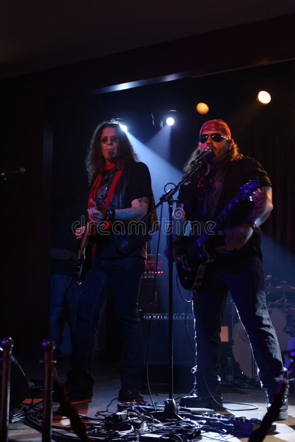 Adrian Barar and Adrian Baciu Igrisan onstage. Singers Adrian Barar and Adrian Baciu Igrisan from Romanian heavy metal band Cargo onstage under spotlights royalty free stock photos
