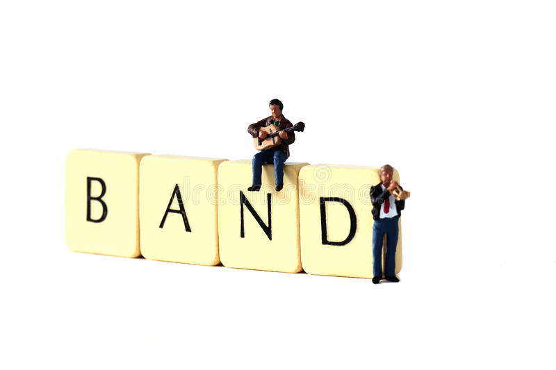 Musicians band B. Miniature models of musicians with tiles spelling band royalty free stock photography