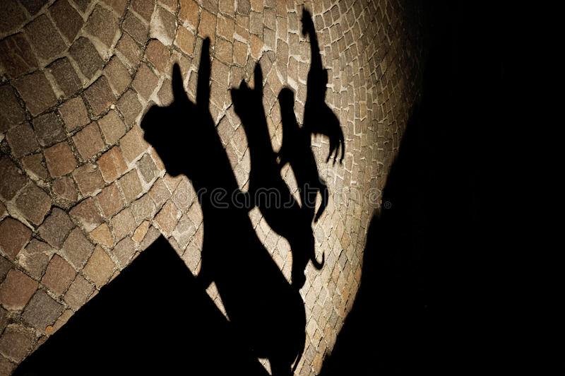 Musicians of Bremen. The shadow of the statue of the Bremen Town Musicians royalty free stock photography