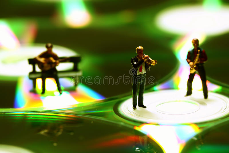 Musicians CD E. Miniature models of musicians on CD discs stock photos