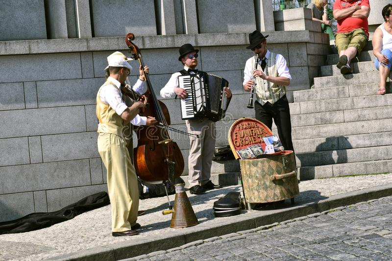 Musicians in the city. Prague, Czech Republic - April 22, 2018: The music group of street musicians of the Prague funfair orchestra publicly performs in the city stock photo