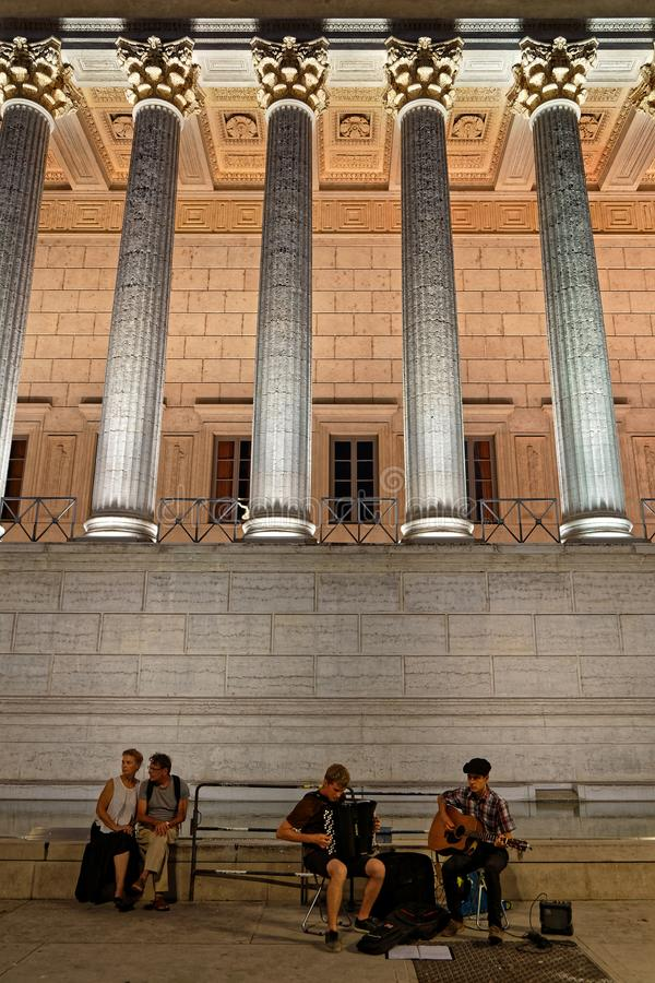 Musicians and columns of Palais de Justice in Lyon stock images