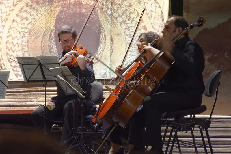 Musicians in concert. Group of musicians called `sextet Stradivarius` in concert in the picturesque setting of the Court Theatre which is located inside the stock photo