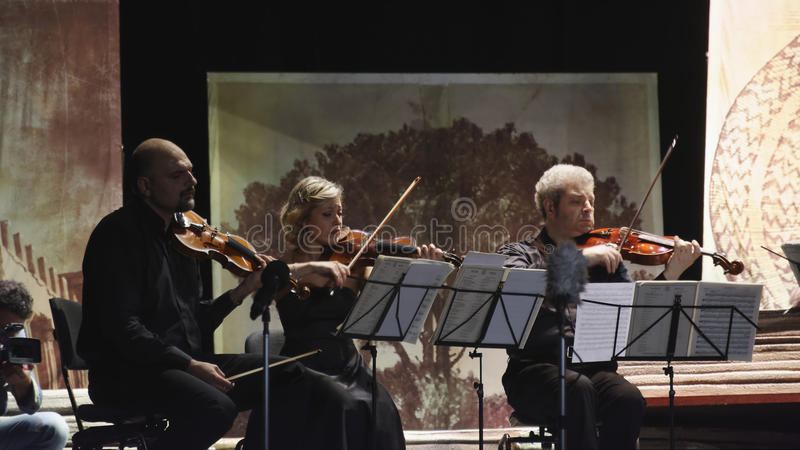 Musicians in concert. Group of musicians called `sextet Stradivarius` in concert in the picturesque setting of the Court Theatre which is located inside the stock photos