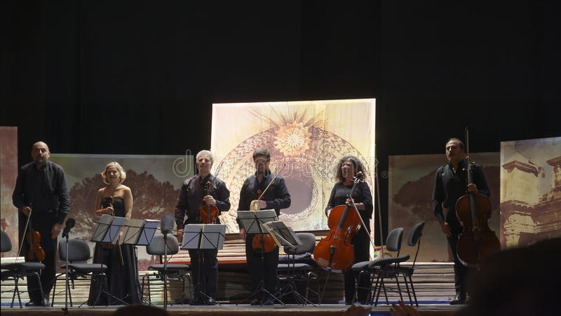 Musicians in concert. Group of musicians called `sextet Stradivarius` in concert in the picturesque setting of the Court Theatre which is located inside the royalty free stock photos
