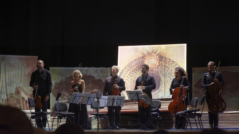 Musicians in concert. Group of musicians called `sextet Stradivarius` in concert in the picturesque setting of the Court Theatre which is located inside the stock images