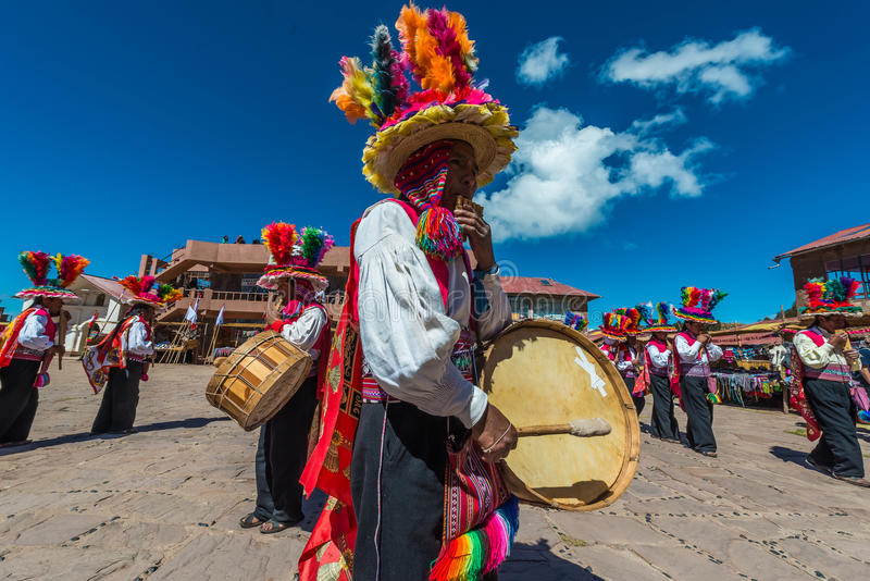 Musicians and dancers in the peruvian Andes at Puno Peru. Puno, Peru - July 25, 2013: musicians and dancers in the peruvian Andes at Taquile Island on Puno Peru royalty free stock photography