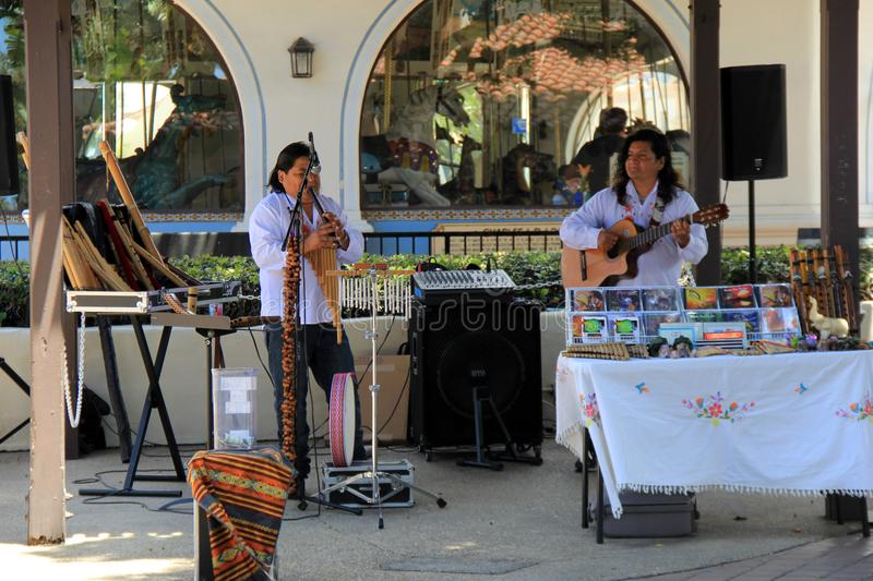 Musicians entertaining people passing by in outdoor shopping center, California, 2016 royalty free stock photo
