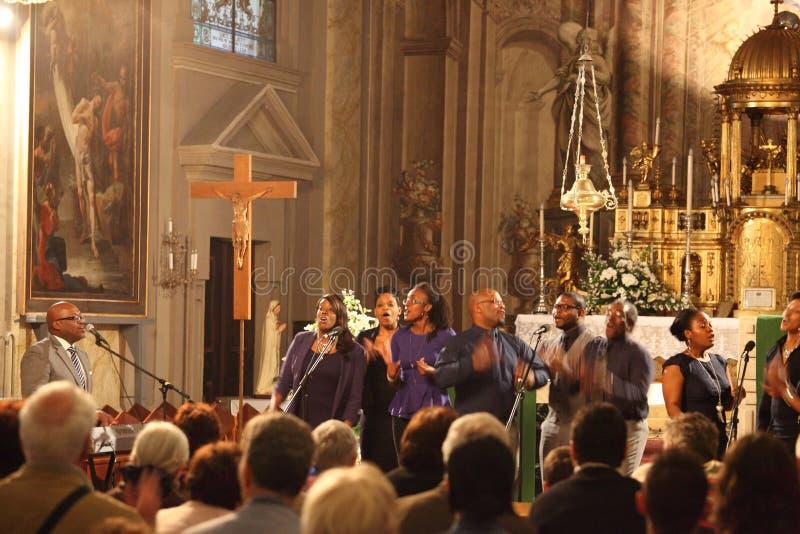 Musicians full of energy and joy. Roman-Catholic Church 'The Holy Trinity', Grand Square, Sibiu City Centre, Transylvania, Romania - June 12, 2013: Sibiu royalty free stock image