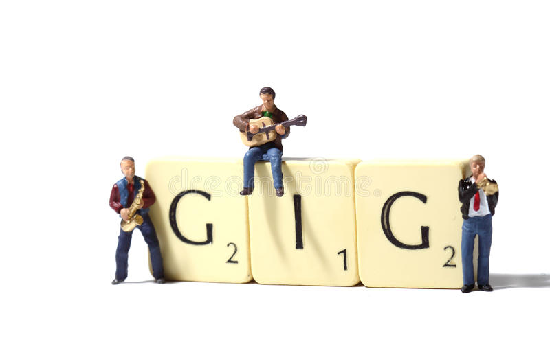 Musicians gig B. Miniature models of musicians with tiles spelling gig stock photography