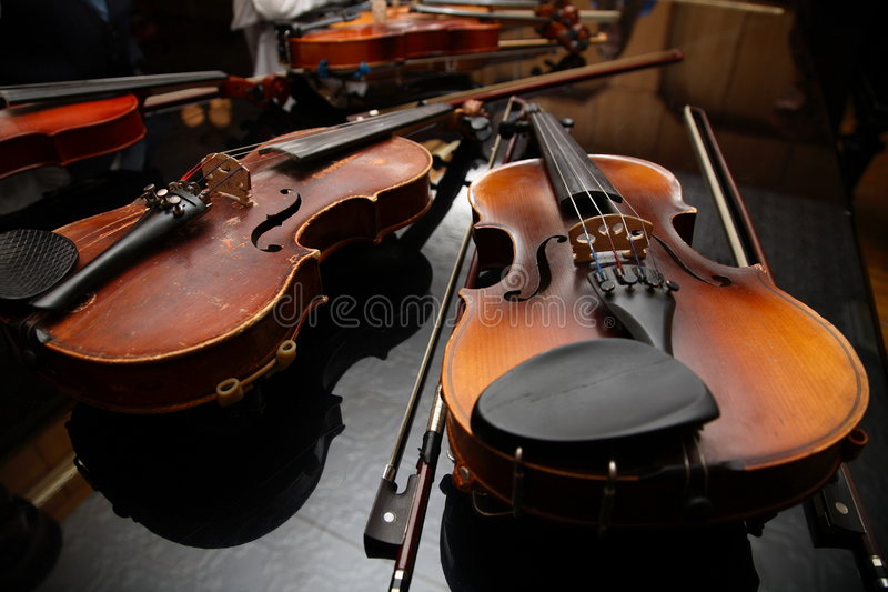 Musicians have a rest. Violin lay on a black background stock photos
