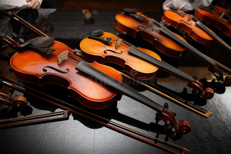 Musicians have a rest. Violin lay on a black background stock image