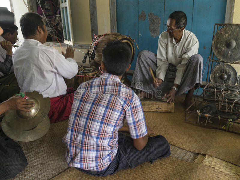 Musicians. The mans in time of playing music on a traditional music instrument during the holidays religious in a small village in Myanmar (Burma stock photo