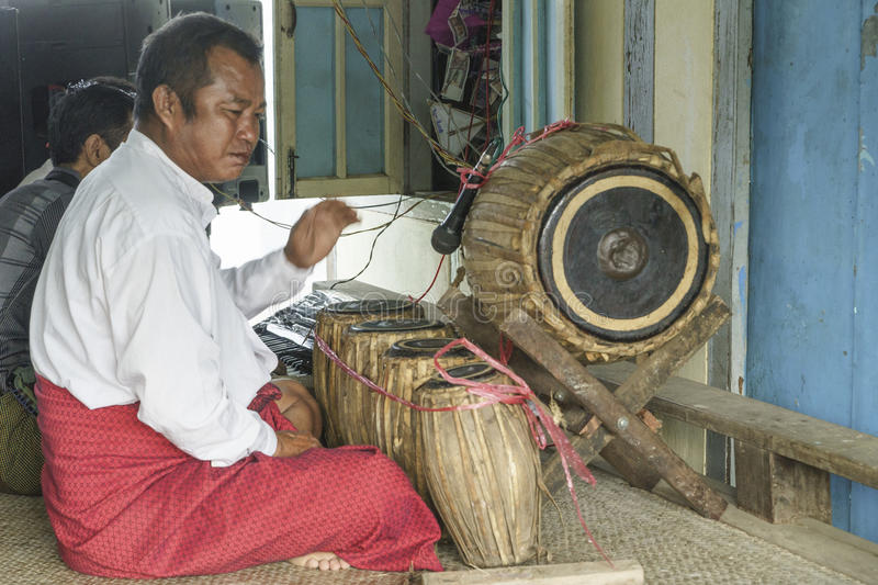Musicians. The mans in time of playing music on a traditional music instrument during the holidays religious in a small village in Myanmar (Burma royalty free stock photography