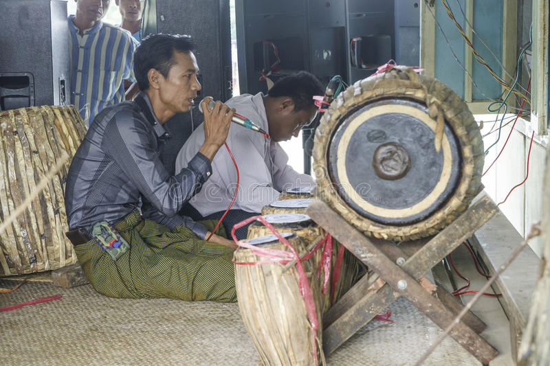 Musicians. The mans in time of playing music on a traditional music instrument during the holidays religious in a small village in Myanmar (Burma royalty free stock images