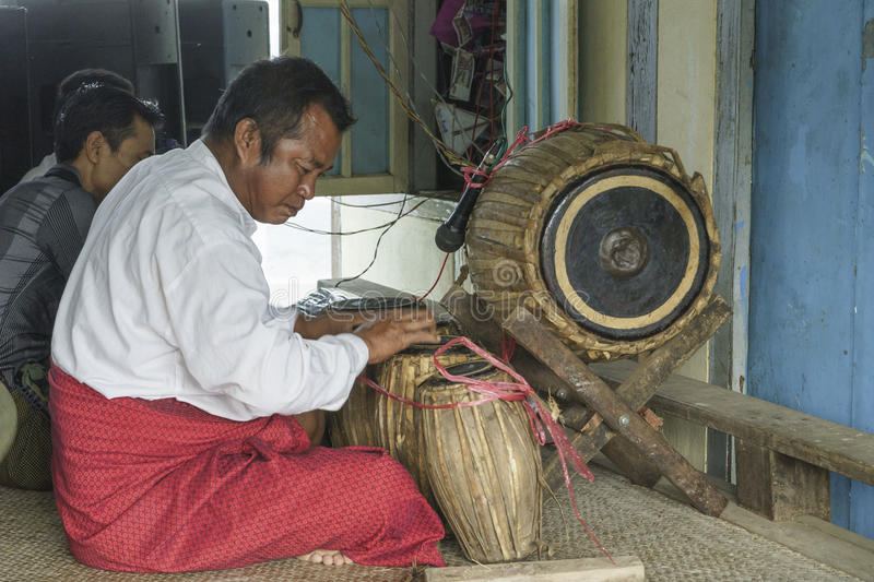 Musicians. The mans in time of playing music on a traditional music instrument during the holidays religious in a small village in Myanmar (Burma stock photos