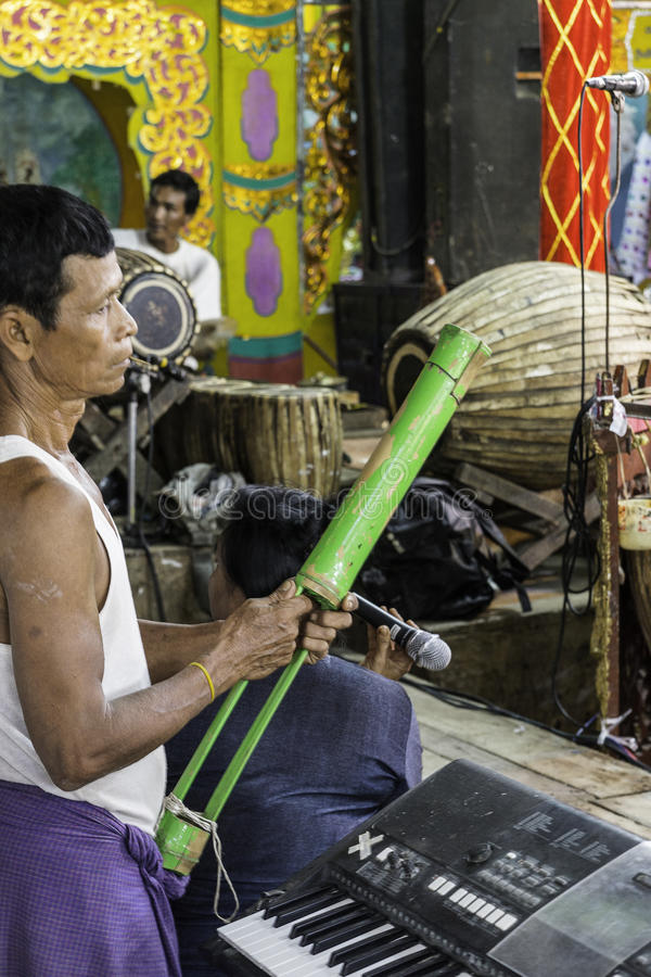 Musicians. The mans in time of playing music on a traditional music instrument during the holidays religious in a small village in Myanmar (Burma royalty free stock image