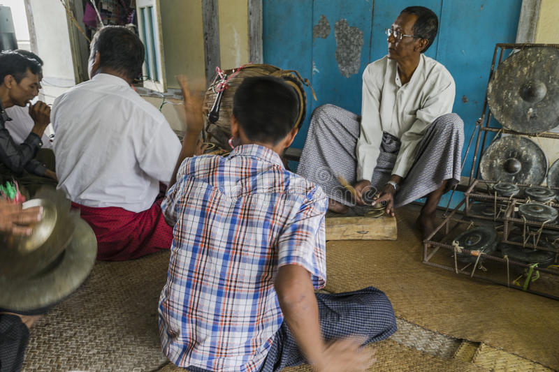 Musicians. The mans in time of playing music on a traditional music instrument during the holidays religious in a small village in Myanmar Burma royalty free stock photography