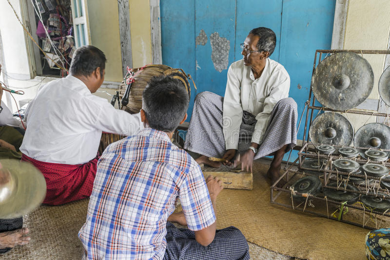 Musicians. The mans in time of playing music on a traditional music instrument during the holidays religious in a small village in Myanmar Burma stock photography