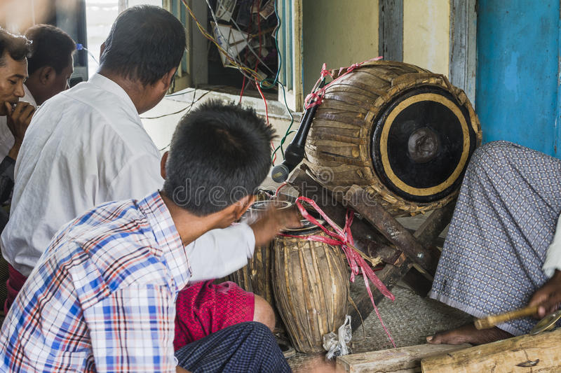 Musicians. The men in time of playing music on a traditional music instruments during the holidays religious in a small village in Myanmar Burma stock photography