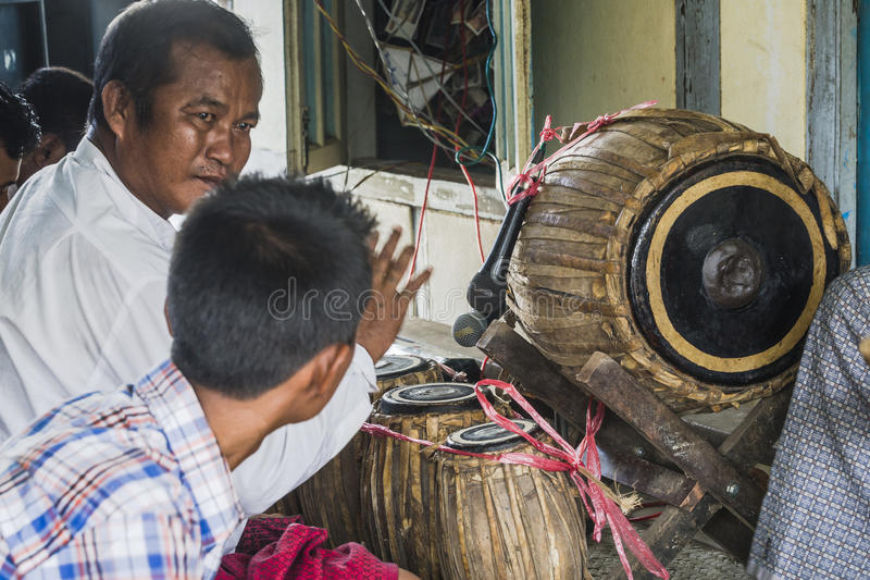 Musicians. The men in time of playing music on a traditional music instruments during the holidays religious in a small village in Myanmar Burma royalty free stock images