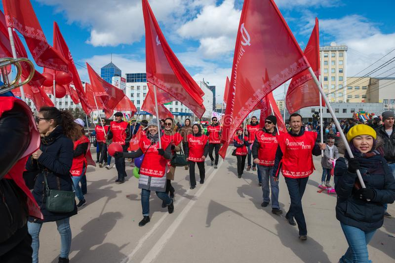 Musicians Philharmonic Orchestra with red flags, on which is written the Philharmonic of Yakutia royalty free stock photo