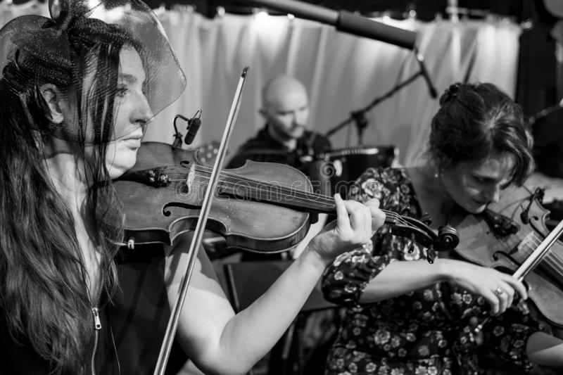 Violinists playing Klezmer at a concert at the Jewish Culture Festival, hosted annually in Kazimierz, Krakow, Poland. Musicians playing at a Klezmer concert at royalty free stock photos