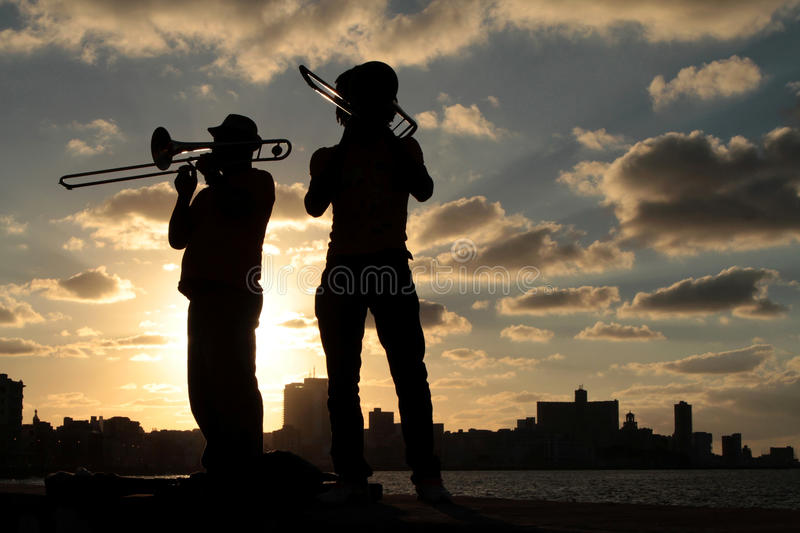 Musicians in the sunset of Havana. HAVANA, CUBA, FEBRUARY 15, 2014 : Musicians in the sunset of Havana. Havana is the largest city in the Caribbean and its royalty free stock photos