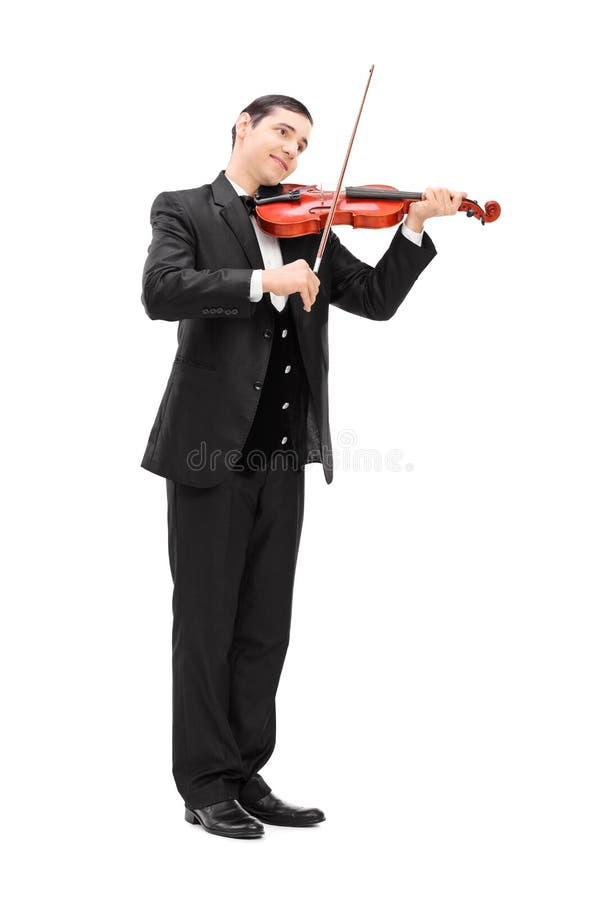 Musicien élégant jouant un violon acoustique image stock