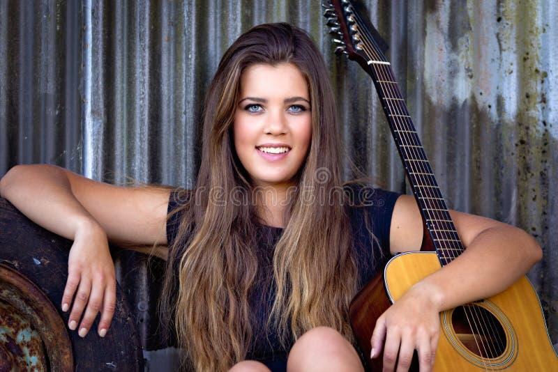 Musicien Woman de guitare image libre de droits