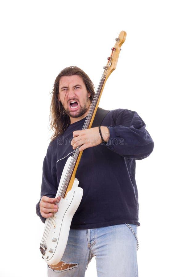 Musicista della roccia che gioca basso elettrico elettrico fotografia stock