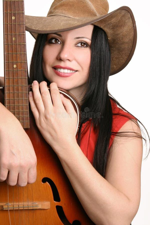 Musicista femminile con la sua chitarra fotografie stock