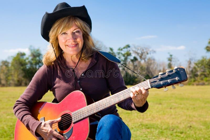 Musicista occidentale del paese immagine stock
