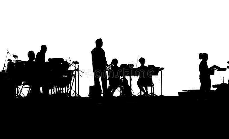 Musicisti della banda rock che giocano sui iPads fotografie stock libere da diritti
