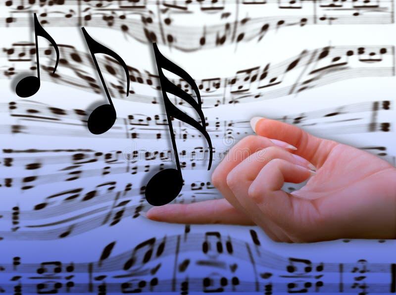 Musik auf ihrem Finger stockfotografie