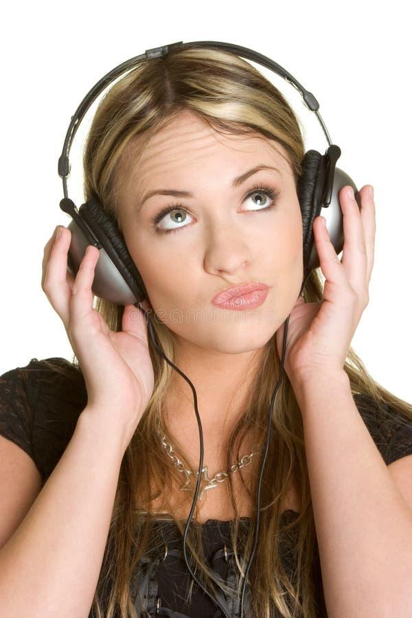 Musik-hörende Frau stockfotografie