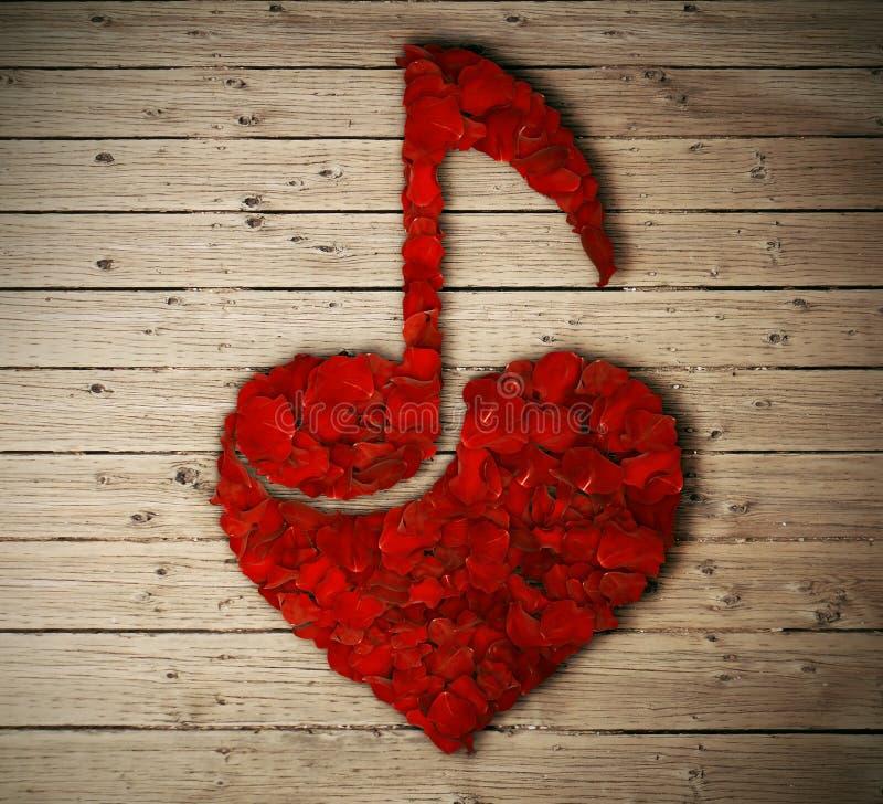 Musik noterar i hjärtan royaltyfria bilder