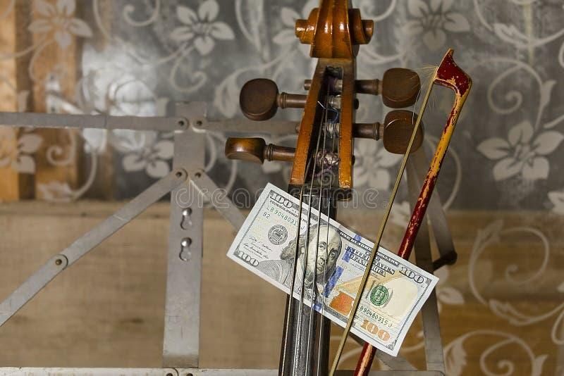 Musik och pengar arkivbild